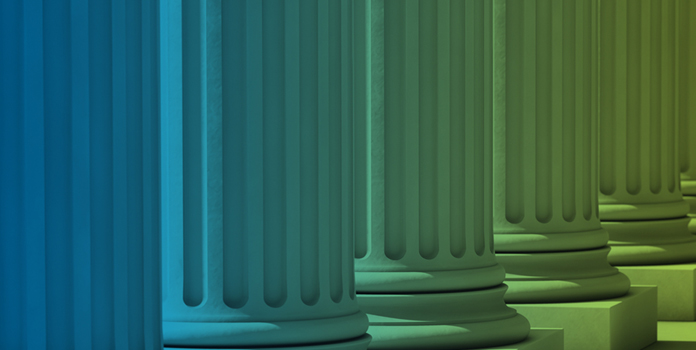 Blue and green tinted photo of building columns
