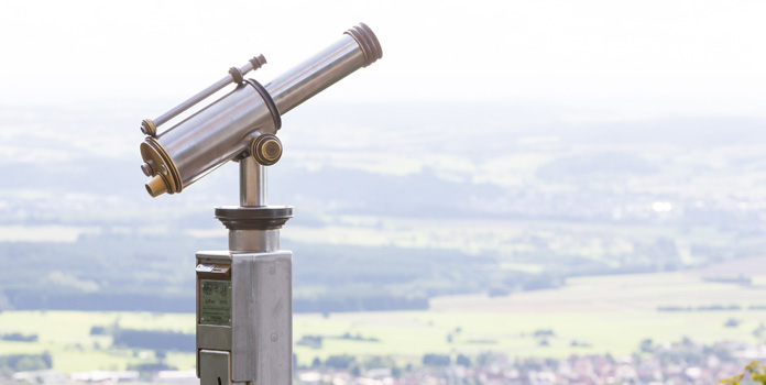 Pay per view monocular looking out over landscape.