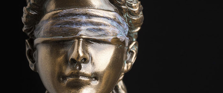 Blindfolded statue