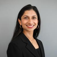 Headshot of Meghan Siripurapu against a grey background