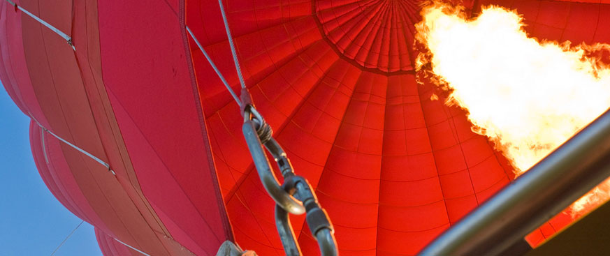 Fixed Income Outlook hero image featuring the inside of a red hot air balloon