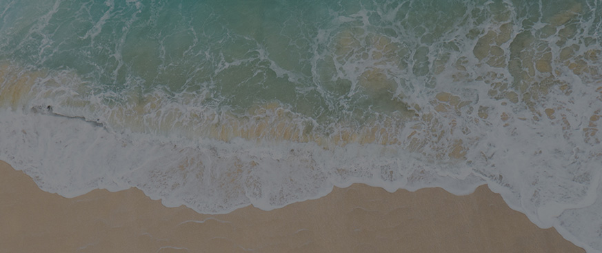 Multi Asset Outlook featured image - includes a top-view photo of a shoreline of a beach