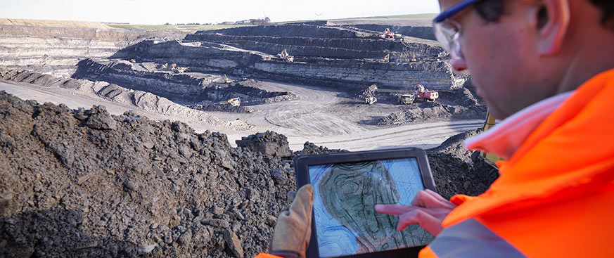 Miner looking at a tablet