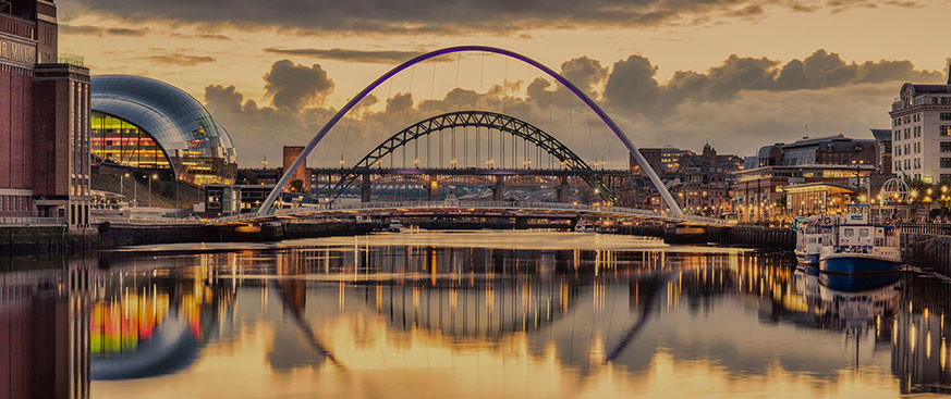 Reflection of a suspension bridge over a river