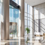 Inside of a brightly-lit office building foyer