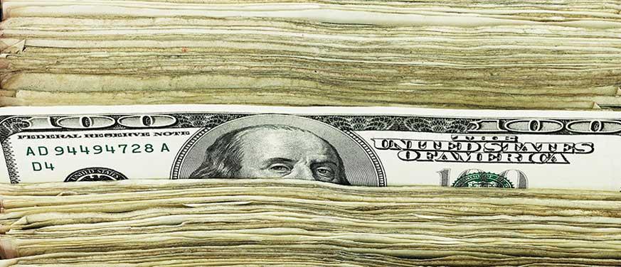 Stacked one hundred dollar bills
